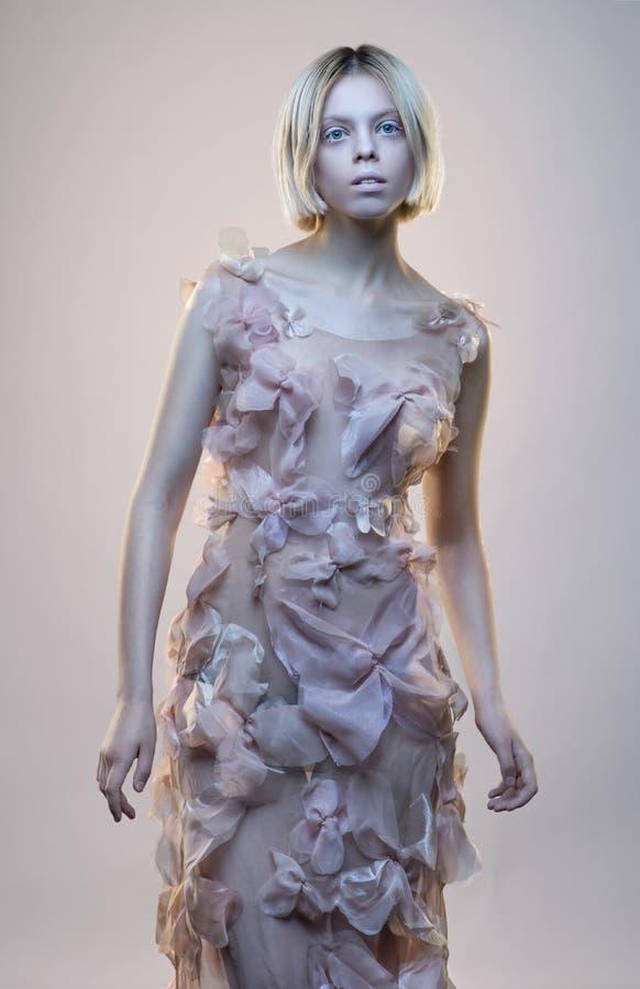 Concept portrait of strange woman. In beige dress stock images