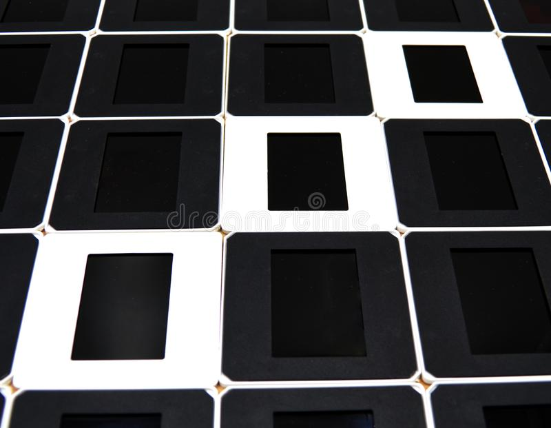 The concept of positives and negatives. Black and white slide frames. Studio shot royalty free stock photos