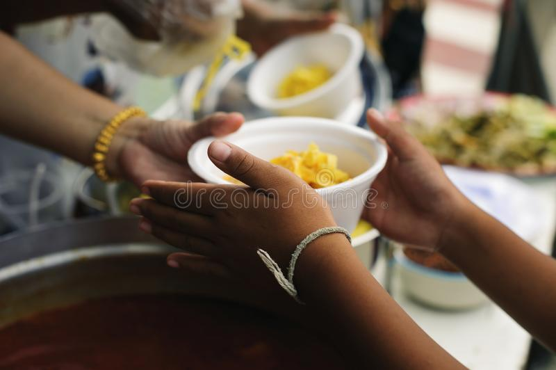 Concept of poverty in Asian society : Charity food is free for people in slums royalty free stock photo