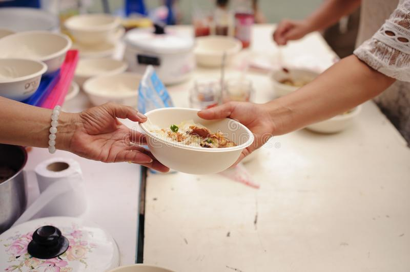 Concept of poverty in Asian society : Charity food is free for people in slums stock photo