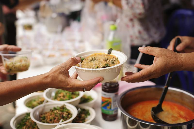 Concept of poverty in Asian society : Charity food is free for people in slums stock photos