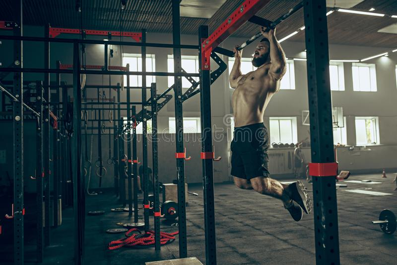 Concept: power, strength, healthy lifestyle, sport. Powerful attractive muscular man at CrossFit gym. Concept: power, strength, healthy lifestyle, sport stock images