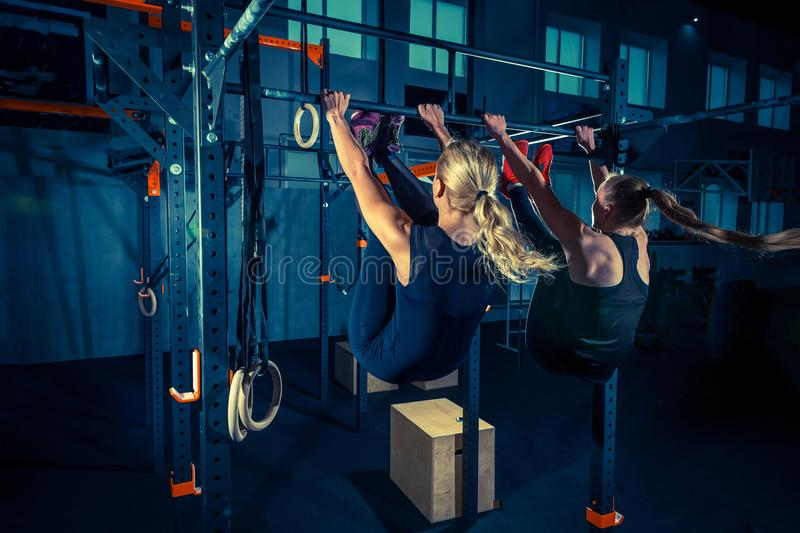 Concept: power, strength, healthy lifestyle, sport. Powerful attractive muscular women at CrossFit gym royalty free stock photography