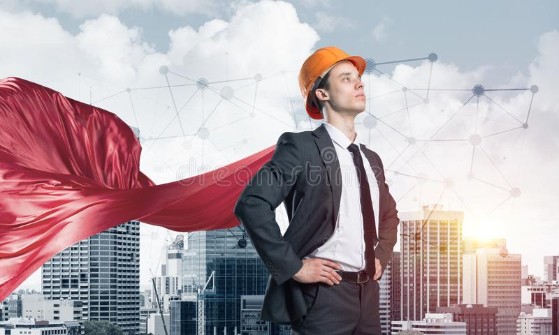 Concept of power and sucess with architect superhero in big city stock image