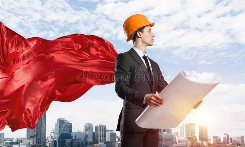 Concept of power and sucess with architect superhero in big city stock photo
