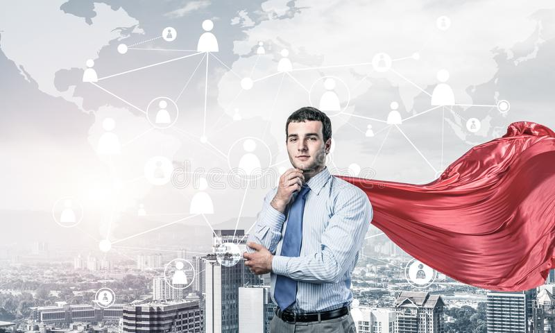 Concept of power and sucess with businessman superhero in big ci stock image