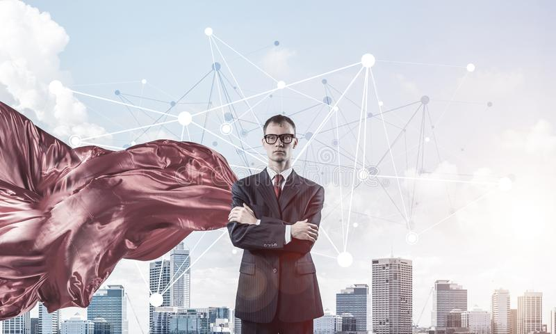 Concept of power and sucess with businessman superhero in big city royalty free stock images