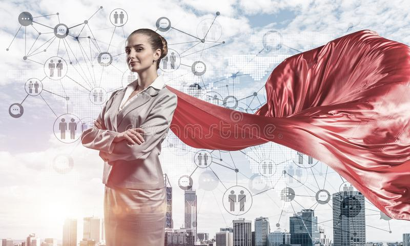 Concept of power and sucess with businesswoman superhero in big city royalty free stock photography