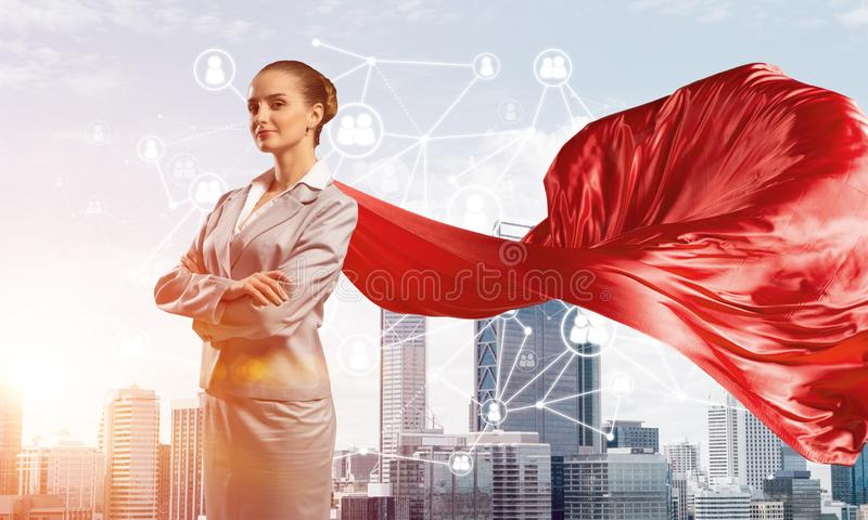 Concept of power and sucess with businesswoman superhero in big city royalty free stock images