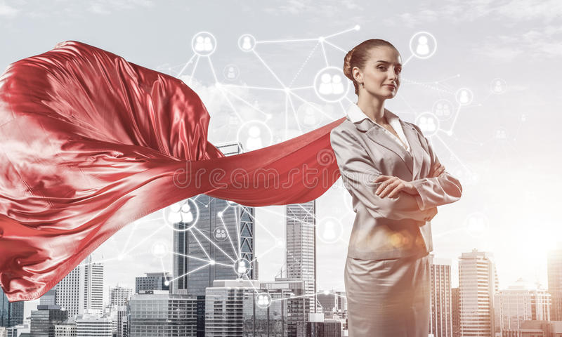 Concept of power and sucess with businesswoman superhero in big royalty free stock photos