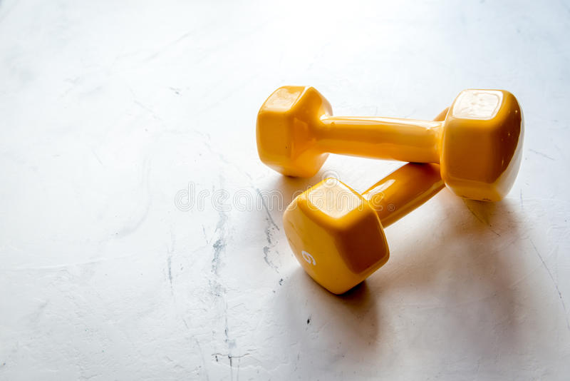 Concept preparing to fitness sports equipment. On gray background royalty free stock photo