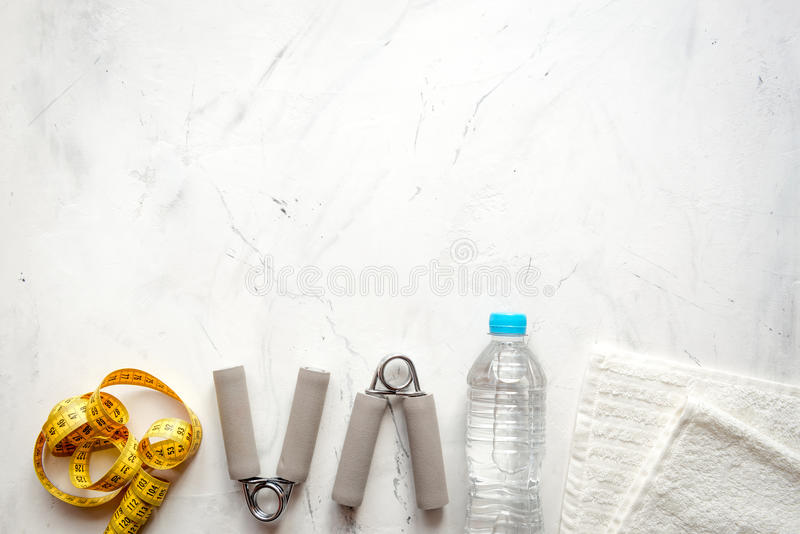 Concept preparing to fitness sports equipment top view. On gray background stock images