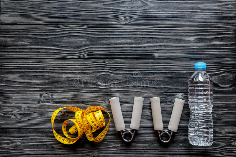 Concept preparing to fitness sports equipment top view mock up. Concept preparing to fitness sports equipment top view on wooden background mock up royalty free stock photography