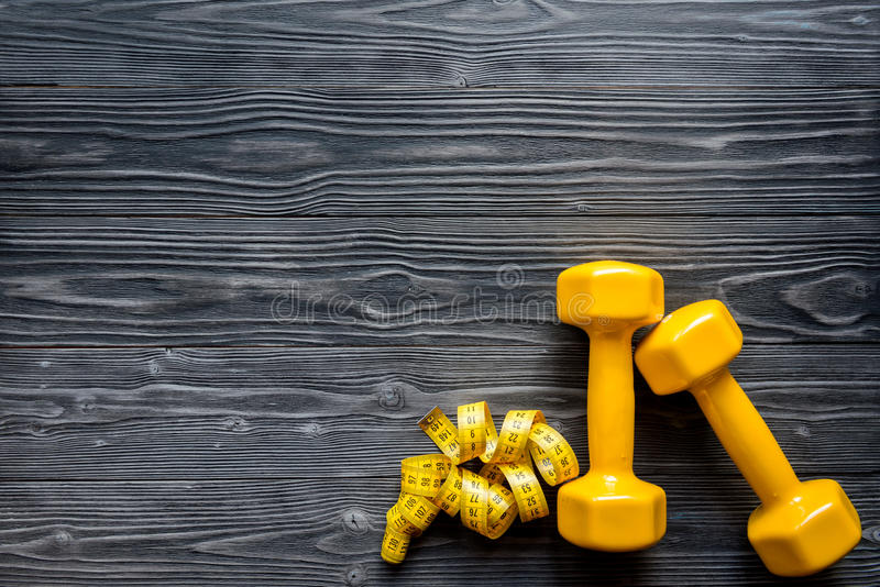 Concept preparing to fitness sports equipment top view mock up. Concept preparing to fitness sports equipment top view on wooden background mock up stock photo