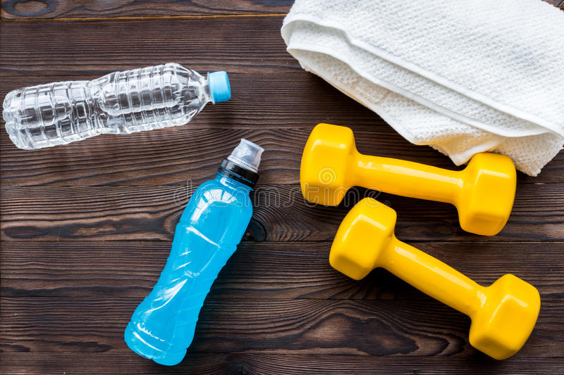 Concept preparing to fitness sports equipment top view. On wooden background royalty free stock photography