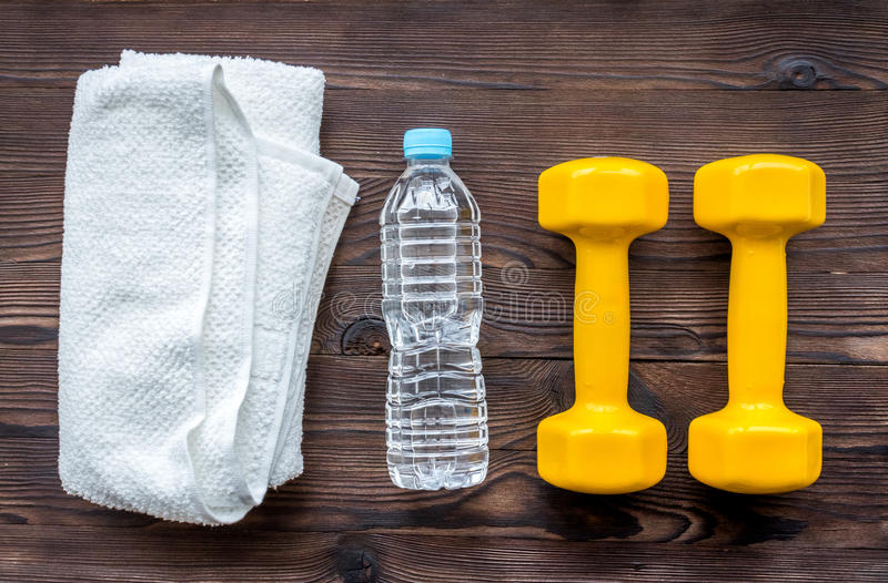 Concept preparing to fitness sports equipment top view. On wooden background stock photo