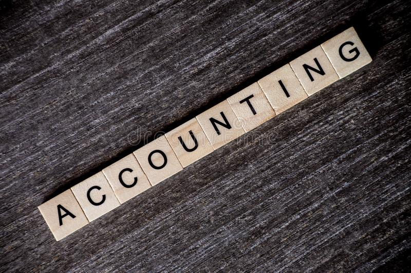 Concept presented by crossword with words accounting with wooden stock image