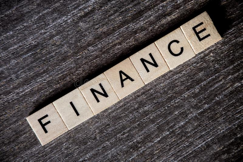 Concept presented by crossword with words finance with wooden cu stock photography