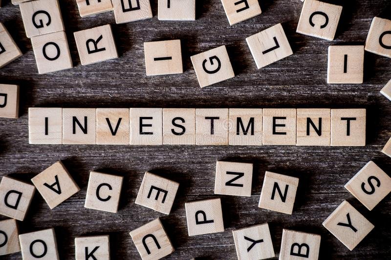 Concept presented by crossword with words investment with many w royalty free stock photo