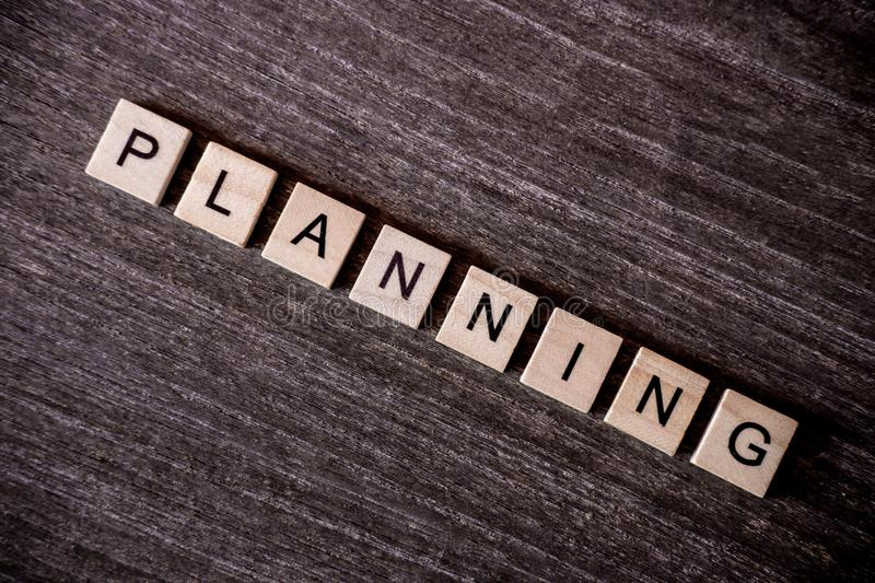 Concept presented by crossword with words planning with wooden c stock images