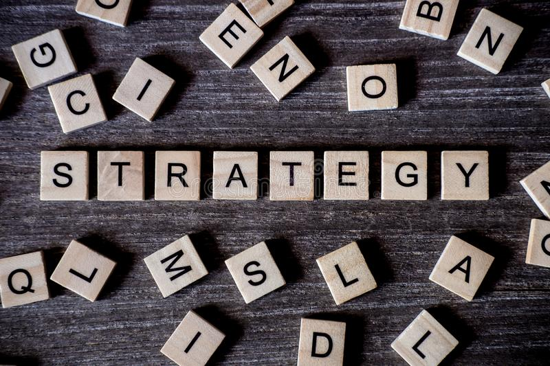 Concept presented by crossword with words strategy with many woo royalty free stock photos