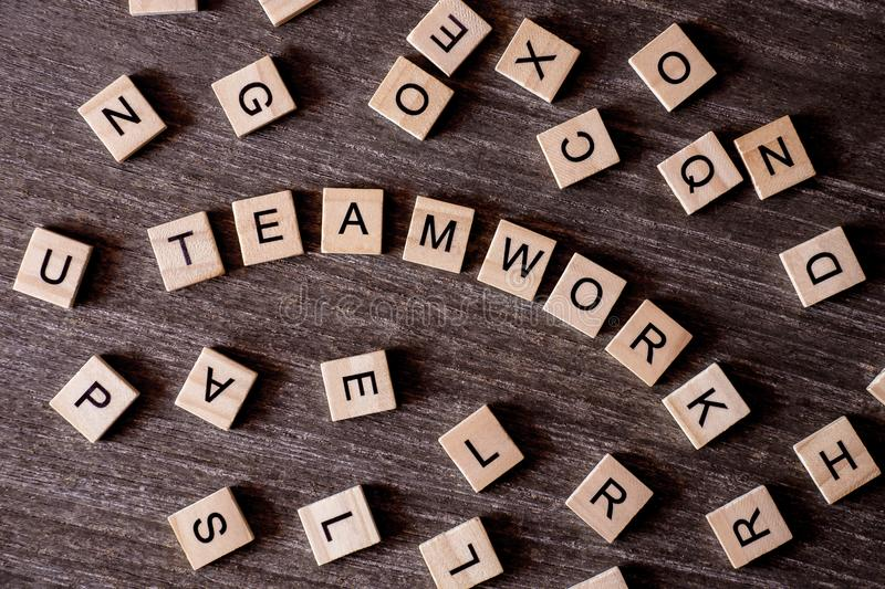 Concept presented by crossword with words teamwork with many woo stock images