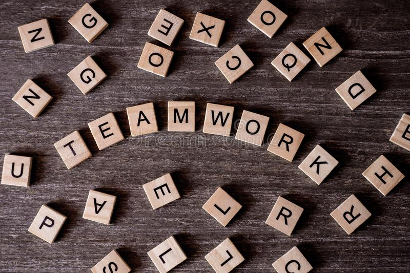 Concept presented by crossword with words teamwork with many woo royalty free stock photography