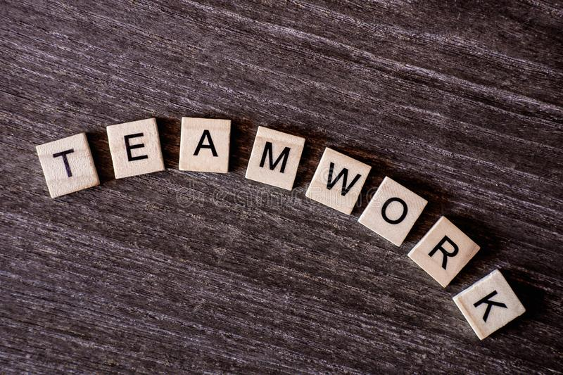 Concept presented by crossword with words teamwork with wooden c stock photo