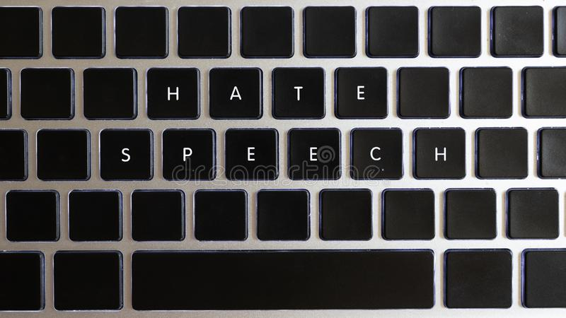 Concept of problems of today internet. Hate speech caption isolated on notebook keyboard with blank keys royalty free stock photos