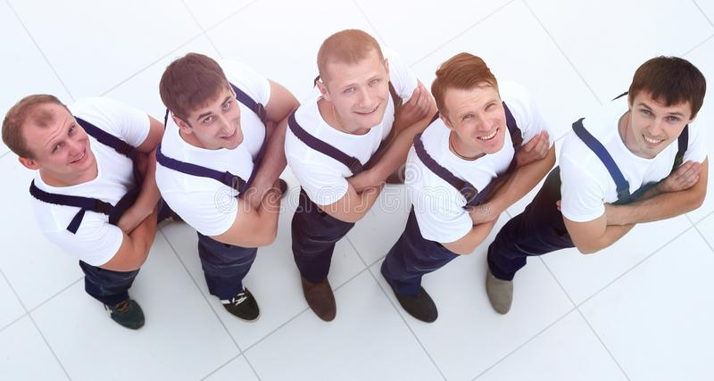 Team of construction professionals is looking up stock image