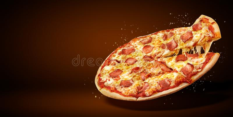 Concept promotional flyer and poster for Restaurants or pizzerias, delicious taste pepperoni pizza, royalty free stock images