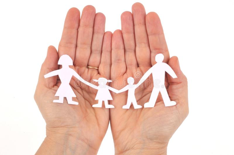 Paper family in hands on white background royalty free stock photos