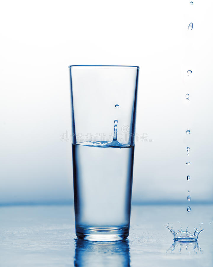The concept of pure artesian cosmetic water. Drops on a white background. Use in cosmetology. stock images