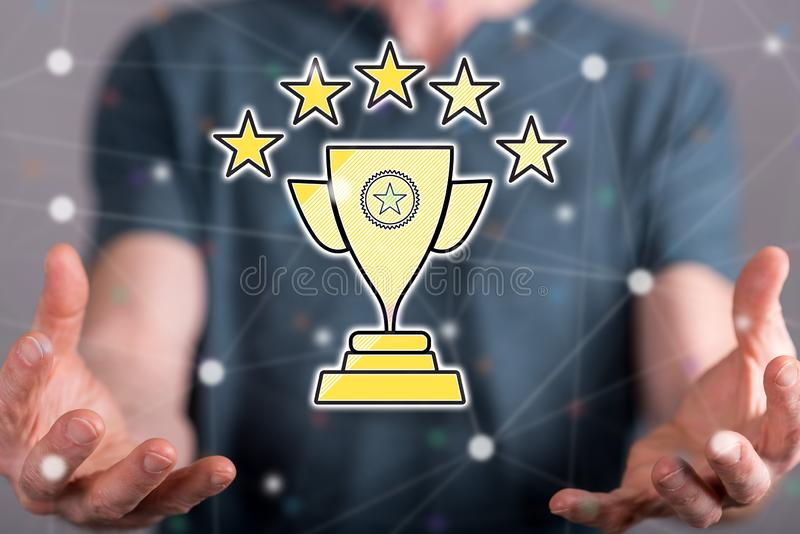 Concept of quality champion. Quality champion concept between hands of a man in background royalty free stock image