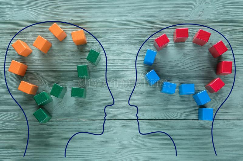 The concept of rational and irrational thinking of two people. Heads of two people with colourful shapes of abstract brain for. Concept of idea and teamwork royalty free stock photo