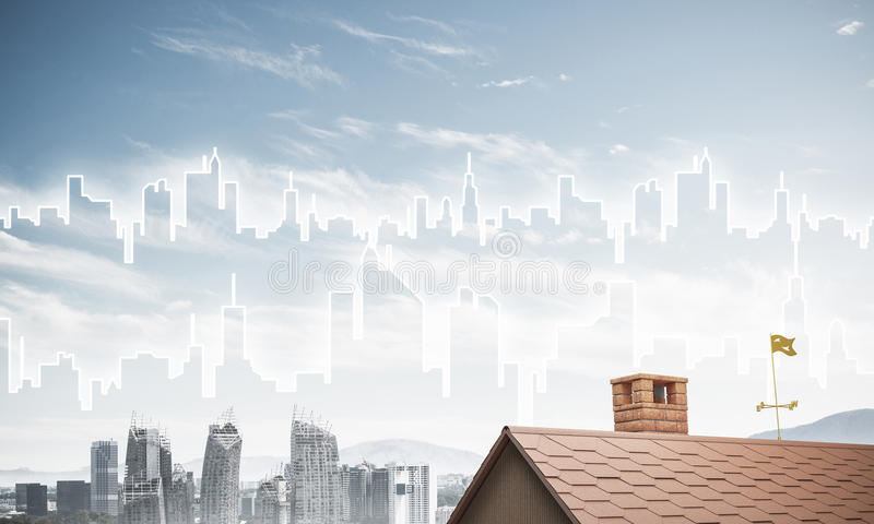 Concept of real estate and construction with drawn silhouette on. Brick house roof and modern cityscape at background royalty free stock photography