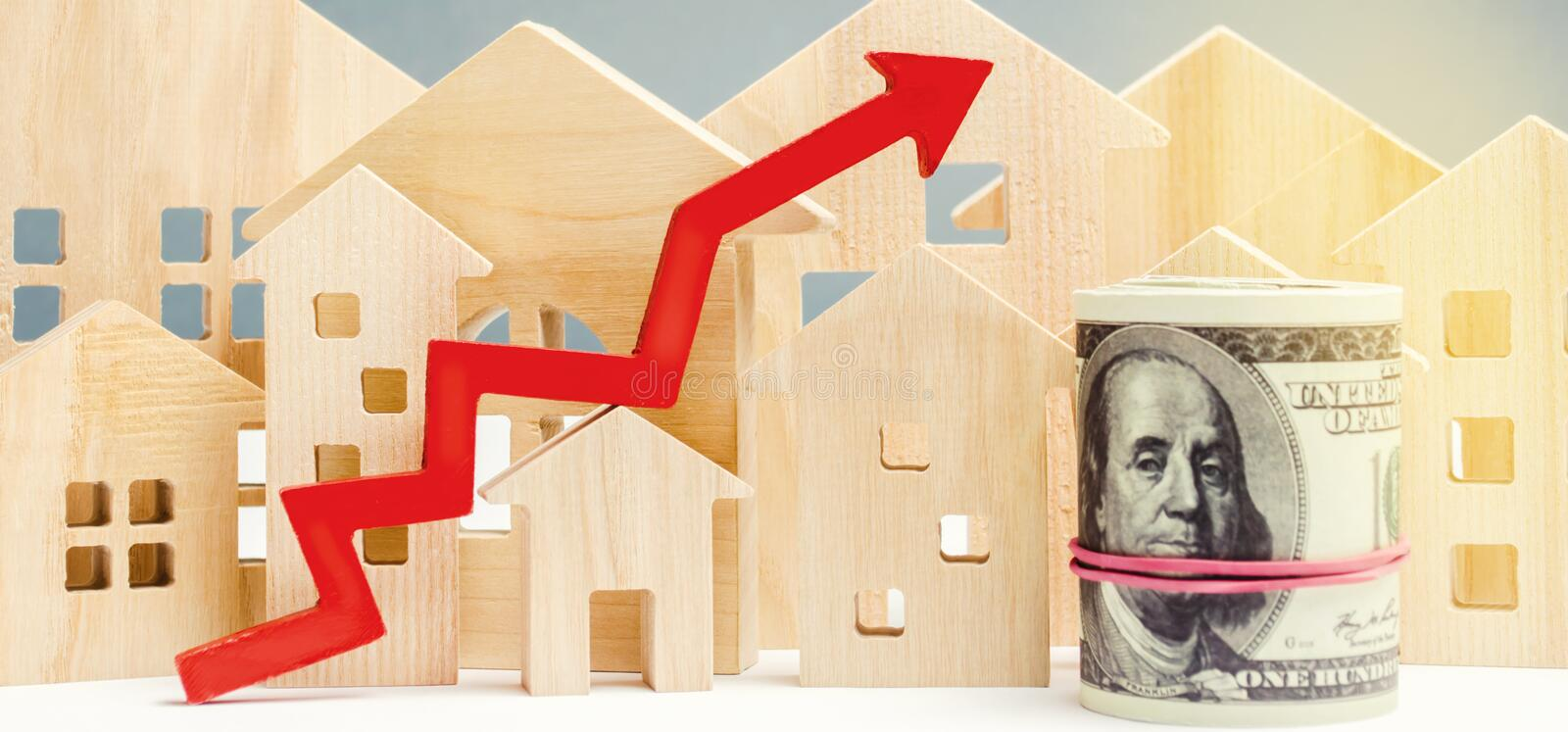 The concept of real estate market growth. The increase in housing prices. Rising prices for utilities. Increased interest. In mortgage and rising interest rates stock image