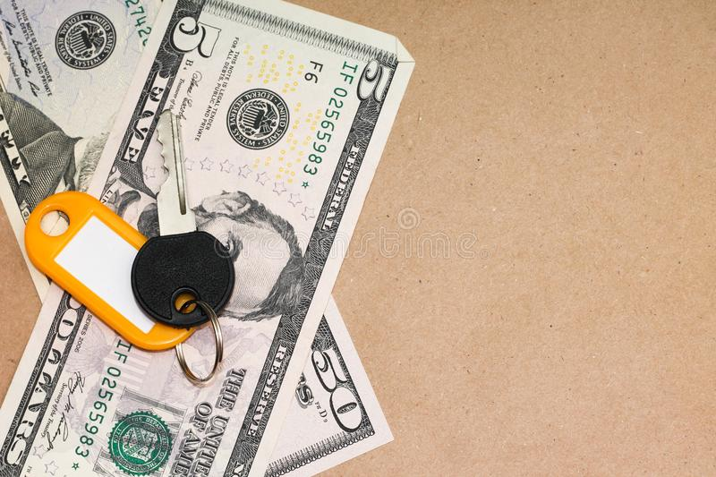 Concept of real estate sales. Key and dollars. Close-up stock image