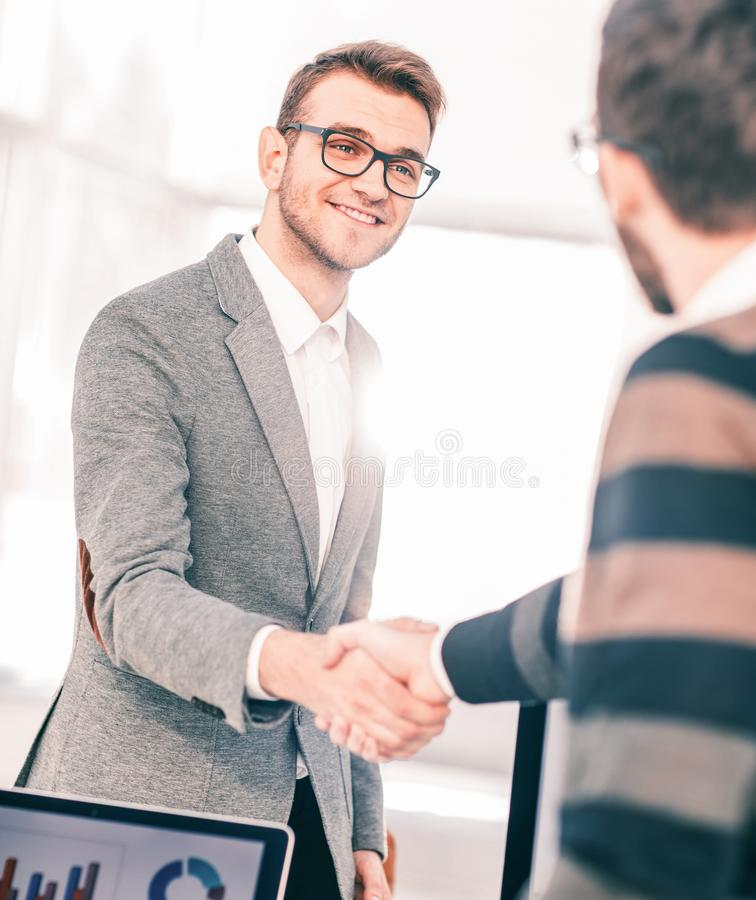 Concept of a reliable partnership - the lawyer and the client, shake hands after signing the financing contract stock image