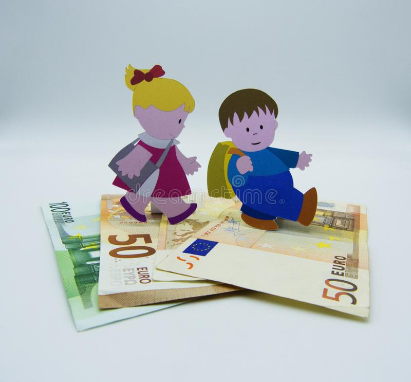 Concept of rising costs of raising children on white background stock photo