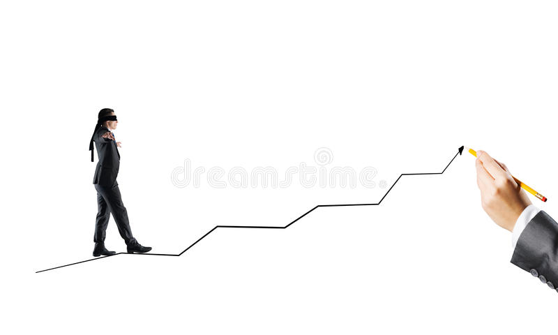 Concept of risk and difficulty with blind businessman steping carefully. Young businessman walking forward on drawn growing graph royalty free stock photography