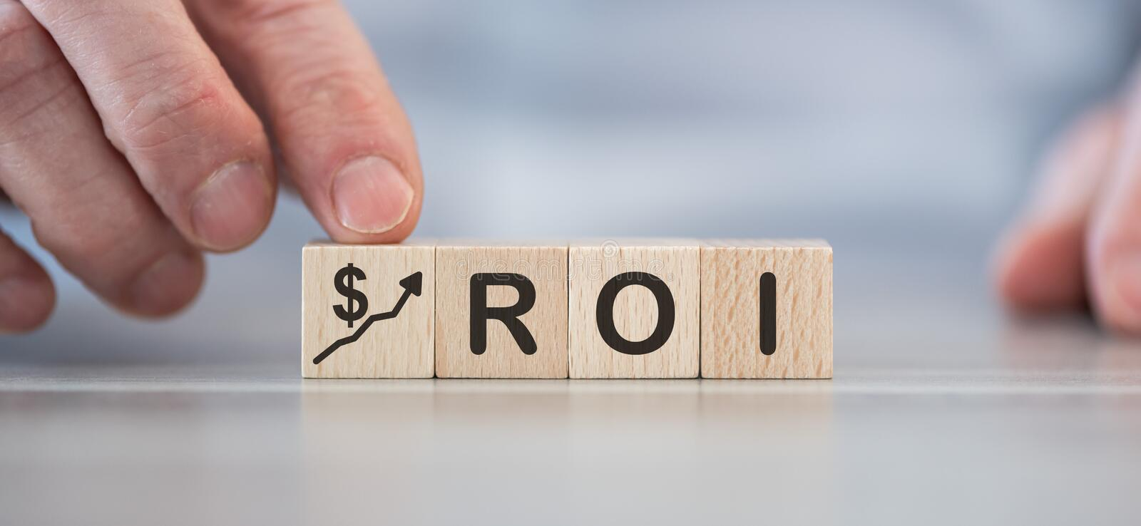 Concept of ROI. On wooden cubes stock images
