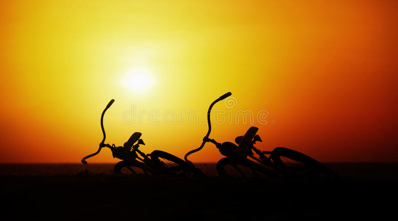 Concept of romance and love - pair vintage bicycles at sunset. Two vintage bicycles at sunset. The concept of romance and love royalty free stock images