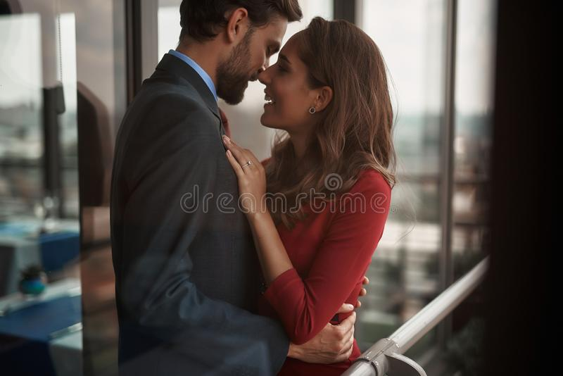 Happy young man and woman staying together outdoor. Concept of romantic engagement. Waist up portrait of happy smiling beloved lady with golden ring on finger stock images