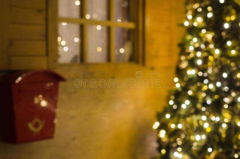Concept of Santa Claus cottage with mailbox and Christmas tree stock images