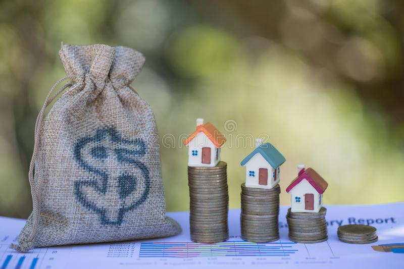 Concept of saving money for house, Savings money for buy house and loan to business investment for real estate concept. Invesment. And Risk Management stock photos