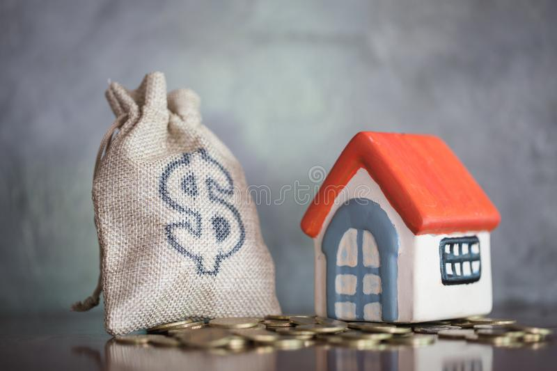 Concept of saving money for house, Savings money for buy house and loan to business investment for real estate concept. Invesment. And Risk Management royalty free stock image