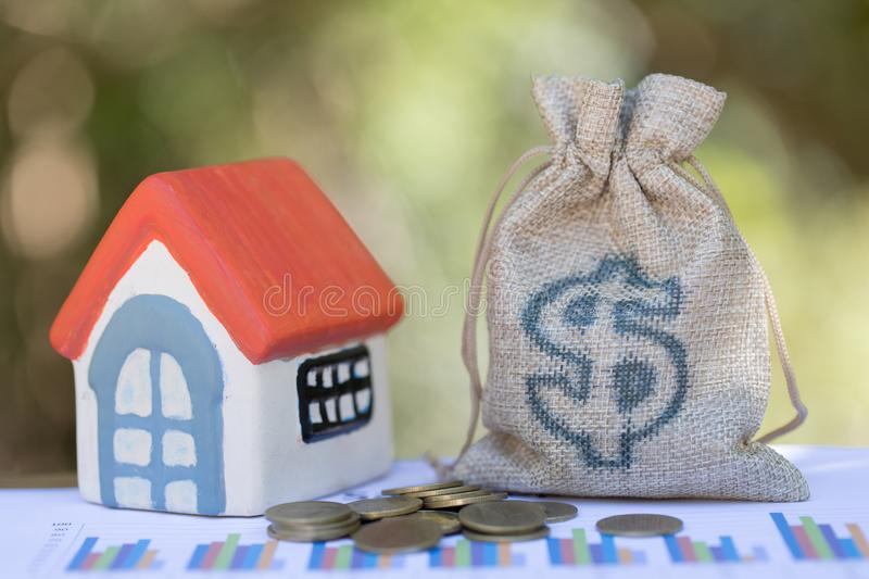 Concept of saving money for house, Savings money for buy house and loan to business investment for real estate concept. Invesment. And Risk Management stock photo
