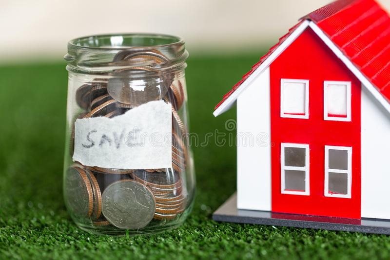 Concept of saving money for house, Savings money for buy house and loan to business investment for real estate concept. Invesment. And Risk Management royalty free stock photos