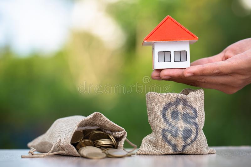 Concept of saving money for house, Savings money for buy house and loan to business investment for real estate concept. Invesment. And Risk Management royalty free stock images